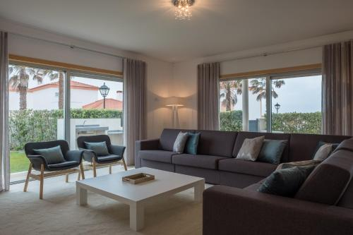 A seating area at Marvellous Villa