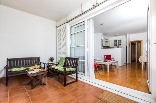 Posedenie v ubytovaní Pretty Green Apartment