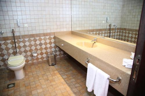Um banheiro em Tulip Inn Riyadh