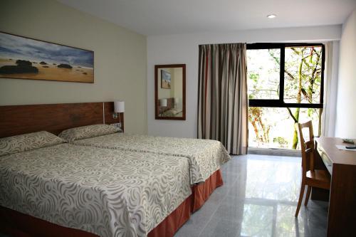 Cama o camas de una habitación en Hotel Torre Del Conde