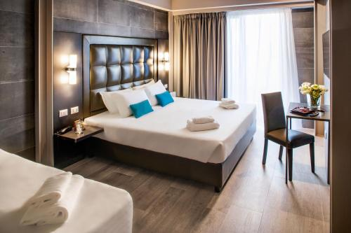 A bed or beds in a room at Spice Hotel Milano