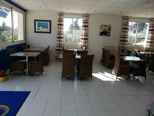 Restaurant ou autre lieu de restauration dans l'établissement Carry Hotel