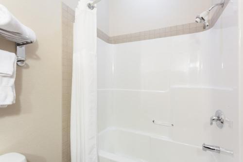 A bathroom at Ramada by Wyndham Westlock