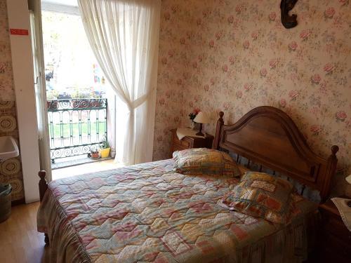 A bed or beds in a room at Residencial Bem Estar