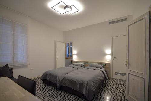 A bed or beds in a room at Carbonaia Venezia