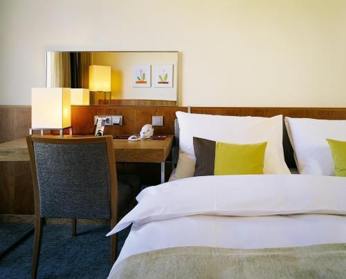 Cama o camas de una habitación en K+K Hotel Elisabeta