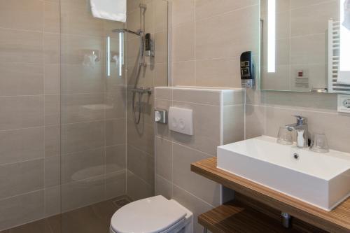 Een badkamer bij Best Western Hotel Den Haag