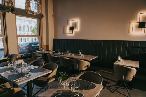 Een restaurant of ander eetgelegenheid bij Hotel New Regina