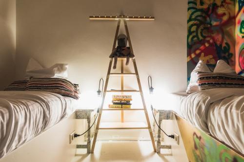 Un ou plusieurs lits dans un hébergement de l'établissement Ecomama