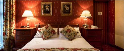 A bed or beds in a room at The White Lion Hotel