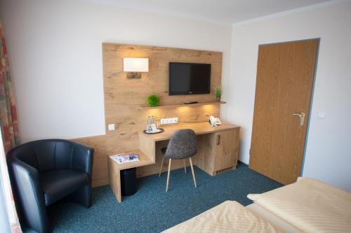 Ein Sitzbereich in der Unterkunft Ruser's Hotel