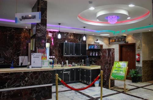 O saguão ou recepção de Dar Al Asalah Hotel-Apartments