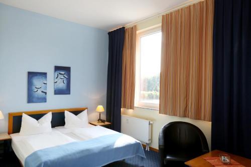 Кровать или кровати в номере H24 Hoteltow