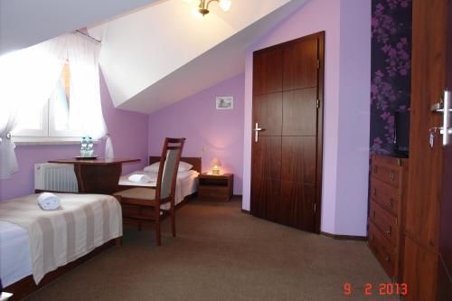 Łóżko lub łóżka w pokoju w obiekcie Pokoje Hotelowe Wiktoria