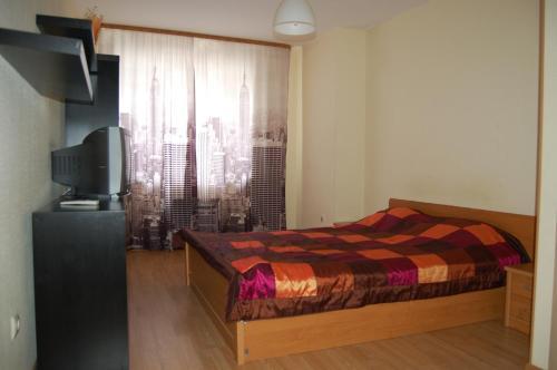 Кровать или кровати в номере Smart Apartment