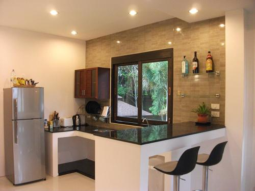 A kitchen or kitchenette at Leelawadee Garden Resort