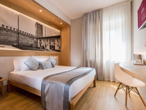 Letto o letti in una camera di SHG Hotel Verona