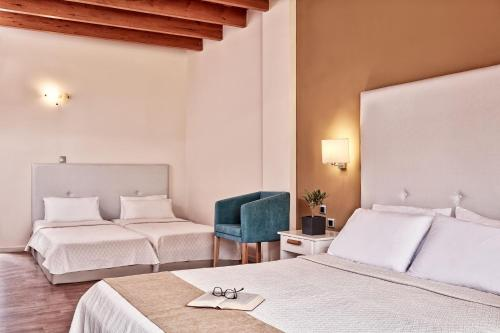 A bed or beds in a room at All Senses Nautica Blue Exclusive Resort & Spa - All Inclusive