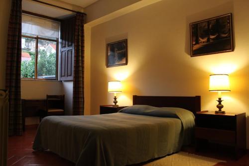 Uma cama ou camas num quarto em Casa da Ponte