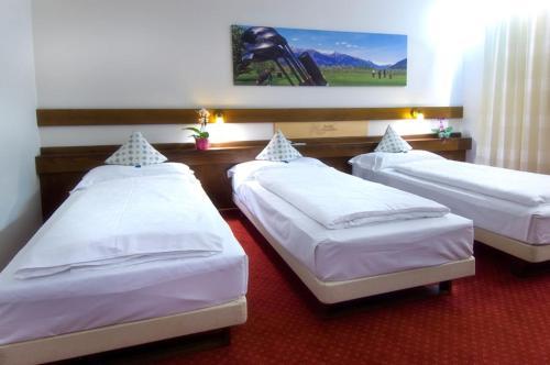 Letto o letti in una camera di Hotel Daniela