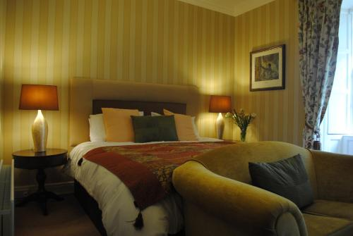 A bed or beds in a room at Killiane Castle Country House & Farm