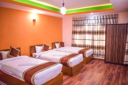 A bed or beds in a room at Kathmandu Peace Home
