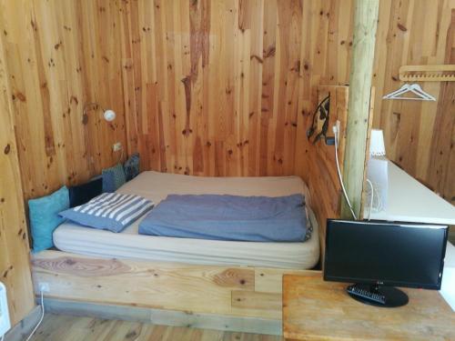 Een bed of bedden in een kamer bij B&B Halen