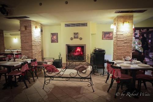 Un restaurant sau alt loc unde se poate mânca la Pensiunea Vlahia Inn