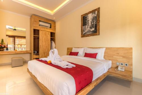 A bed or beds in a room at Bliss Ubud Abangan