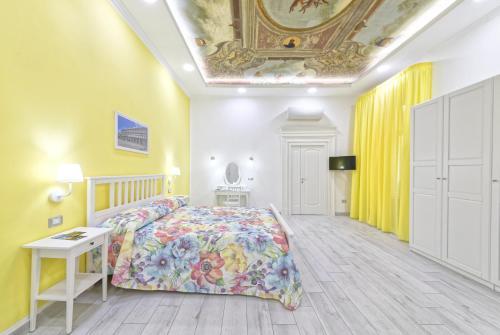 Letto o letti in una camera di B&B Rest a Napoli