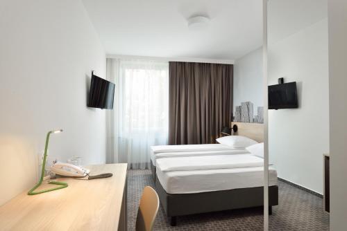 Cama o camas de una habitación en B&B Hotel Ljubljana Park