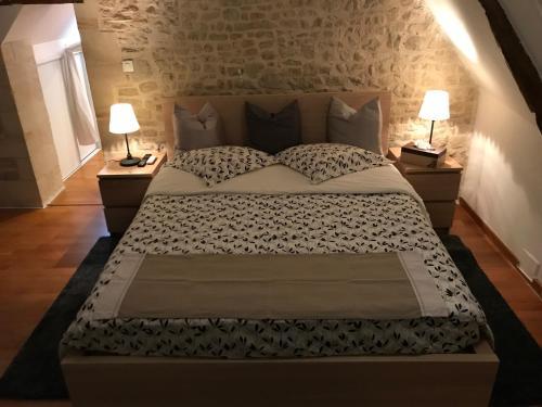Un ou plusieurs lits dans un hébergement de l'établissement Chambre Centre Ville de Bayeux