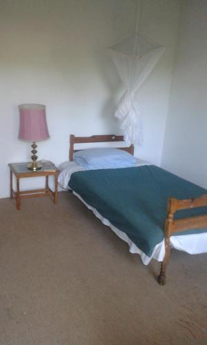A bed or beds in a room at Weaver's Nest