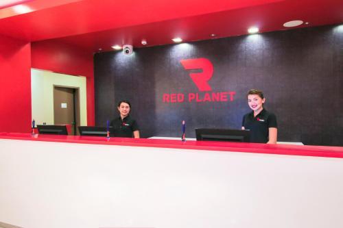 Staff members at Red Planet Cagayan De Oro