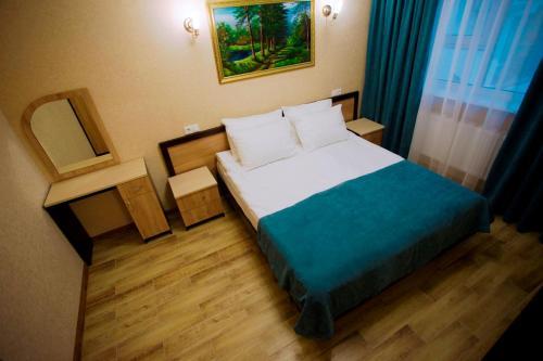 Кровать или кровати в номере Венера -1