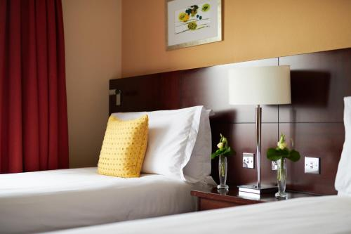 A bed or beds in a room at The Chelsea Harbour Hotel