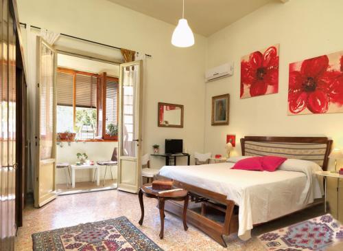 Cama o camas de una habitación en Residenza Oltrarno