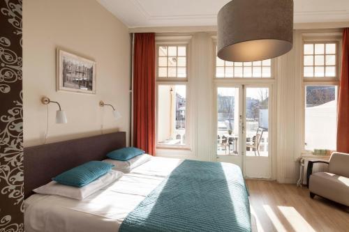 Een bed of bedden in een kamer bij Hotel XL