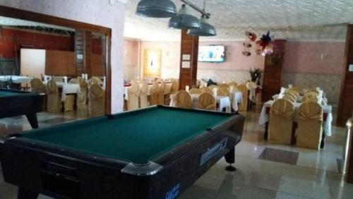 A pool table at Hotel Privilege