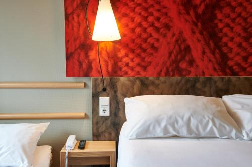 A bed or beds in a room at ibis Tilburg