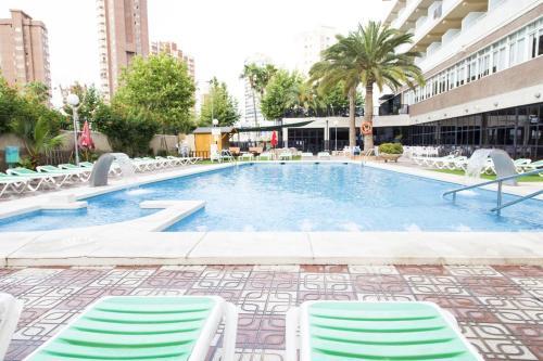 The swimming pool at or near Hotel Joya