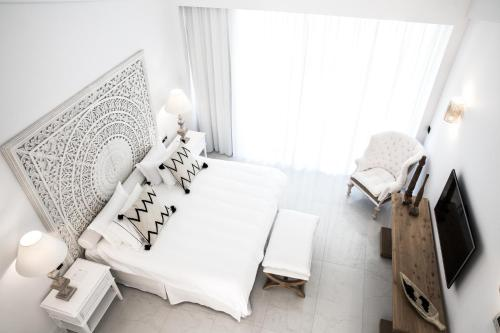 A bed or beds in a room at Abaton Island Resort & Spa