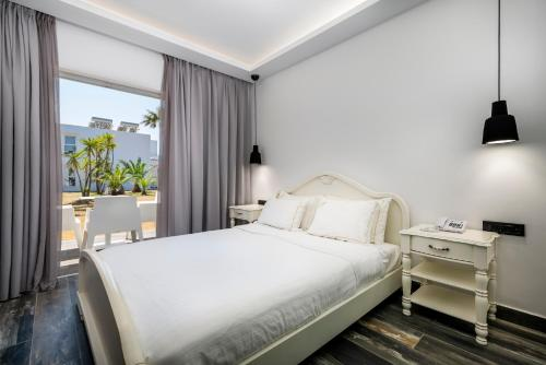 A bed or beds in a room at Diamond Boutique Hotel