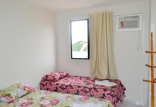 Cama ou camas em um quarto em Apartamentos Natal