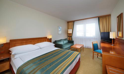 A bed or beds in a room at Quality Hotel Brno Exhibition Centre