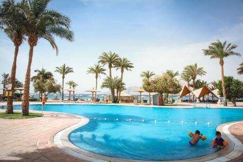 Het zwembad bij of vlak bij Tirana Dahab Resort