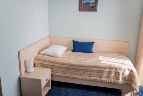 Кровать или кровати в номере Гостиница Зихия