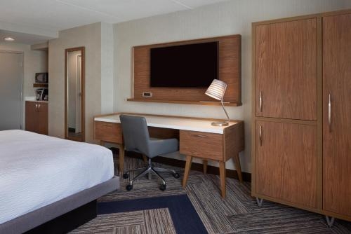 A television and/or entertainment center at Four Points by Sheraton Hamilton - Stoney Creek