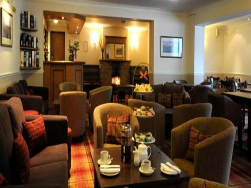 A restaurant or other place to eat at Dunollie Hotel 'A Bespoke Hotel'