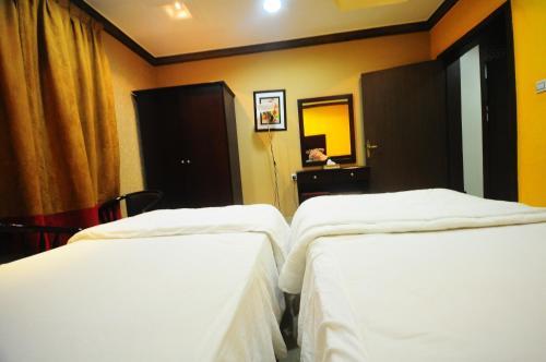 Cama ou camas em um quarto em Tonova Apartment